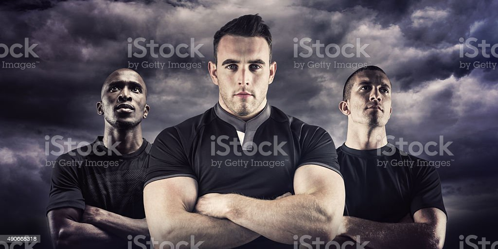 Composite image of tough rugby player looking at camera stock photo