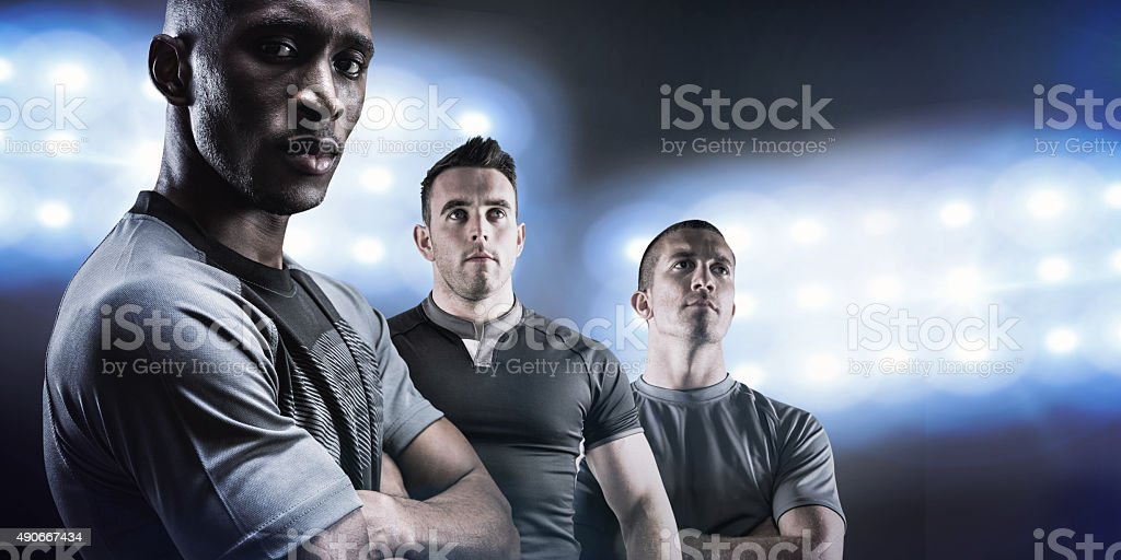 Composite image of tough rugby players stock photo