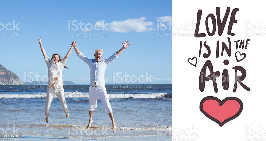Composite image of valentines couple at beach stock photo