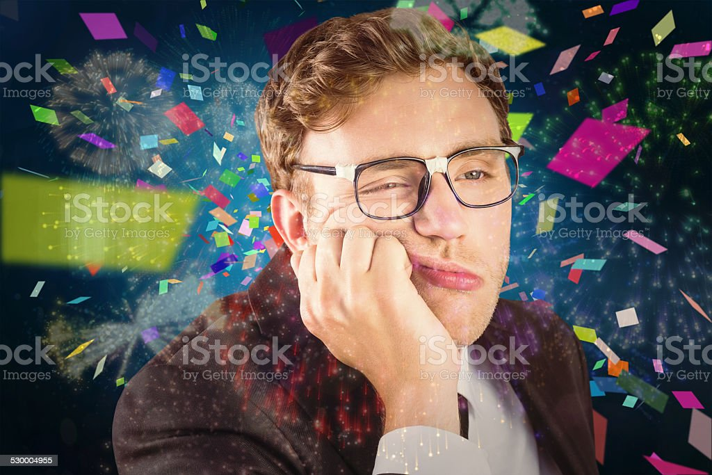 Composite image of young geeky businessman looking bored stock photo