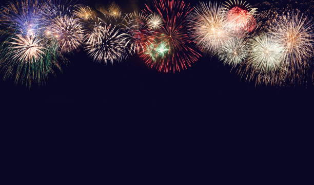 Composite of fireworks for New Year for holiday background stock photo
