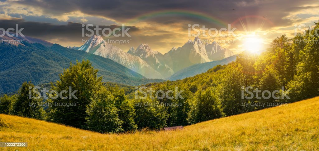 composite summer landscape in mountains at sunset stock photo