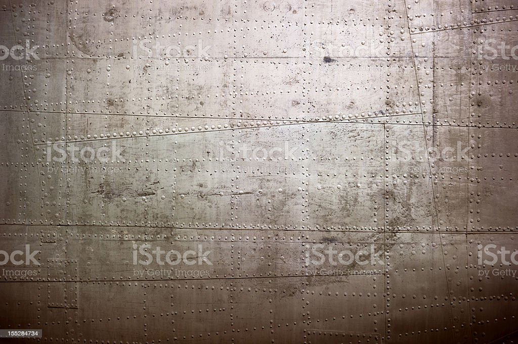 Composite textured metal surface for steampunk background or texture royalty-free stock photo