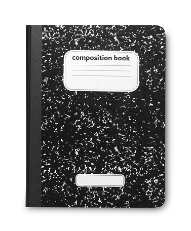 A student's old black and white marble composition book. Scratches on cover due to old nature of book. Isolated on white with soft shadow.