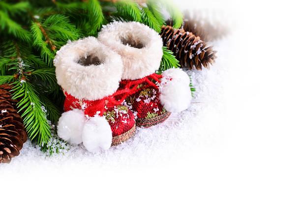 komposition für weihnachten - lammfellstiefel stock-fotos und bilder