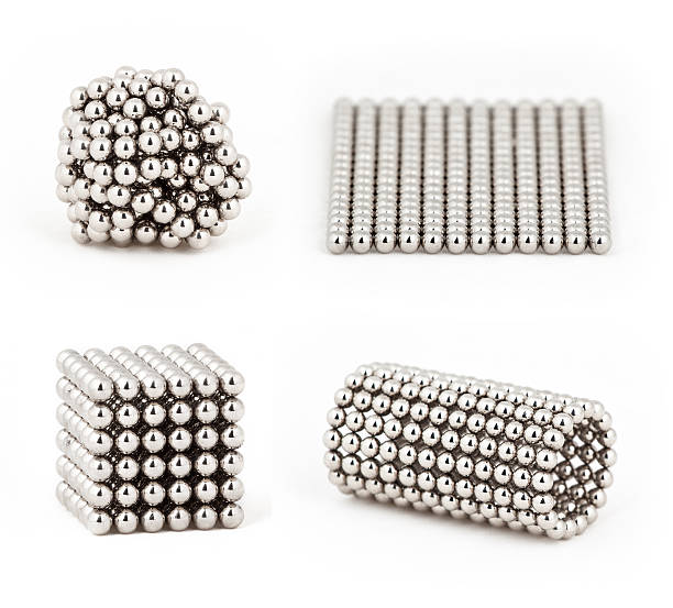 Composition from magnetic metal balls, from chaos to ideal shape stock photo