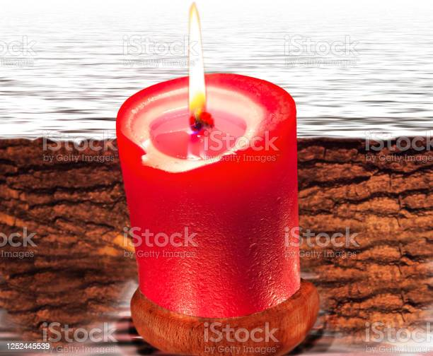 Photo of Composition from red candle and water
