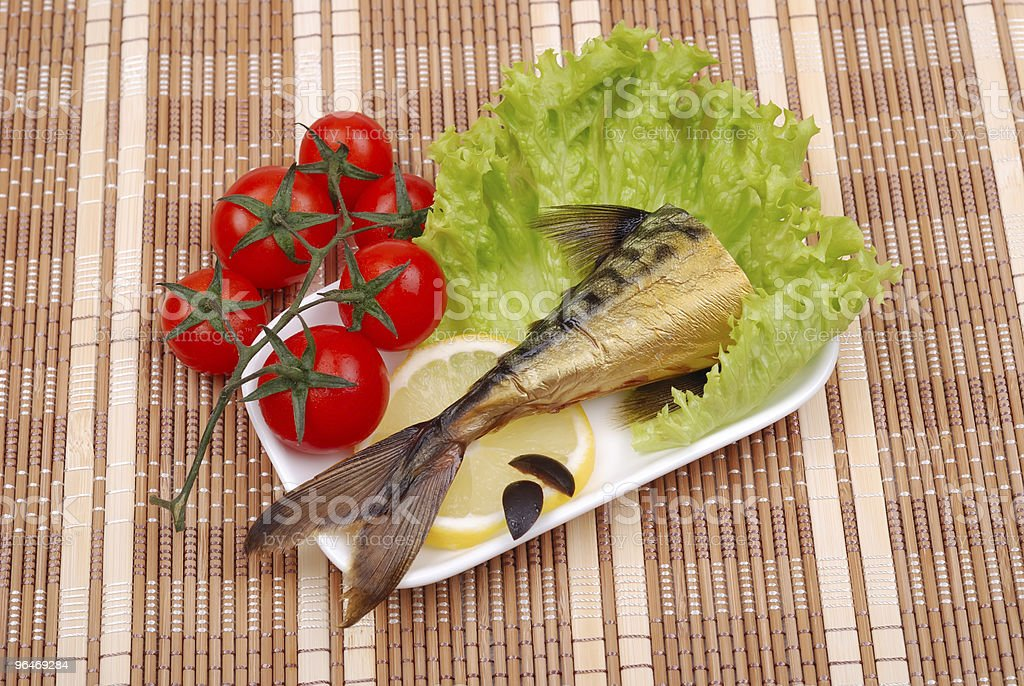 Composition from smoked mackerel on a plate royalty-free stock photo