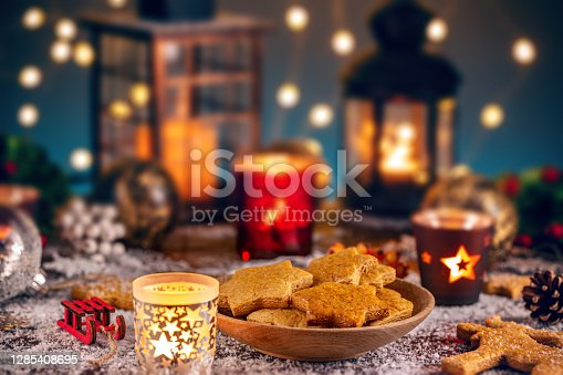 Composition gingerbread cookies and candle for Christmas card