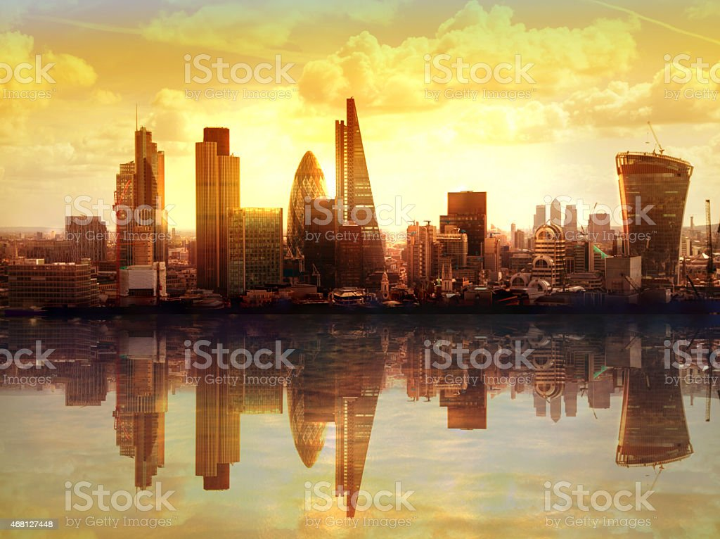 Composition: London in sunset with reflection in Thames water stock photo