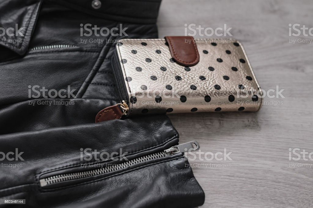 Composition of a jacket and a purse. stock photo