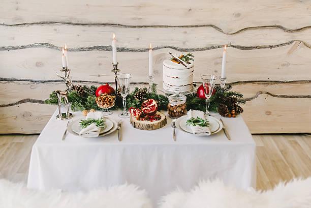 composition of a new year dinner for a couple - roten küchentische stock-fotos und bilder