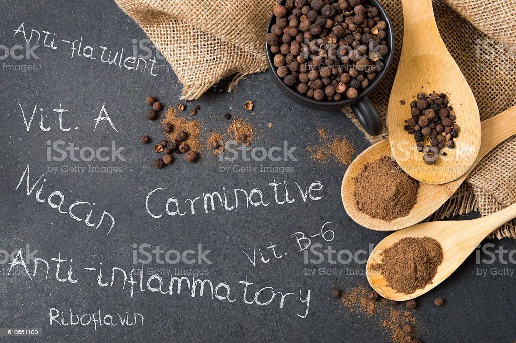 Composition of allspice on a stone countertop stock photo