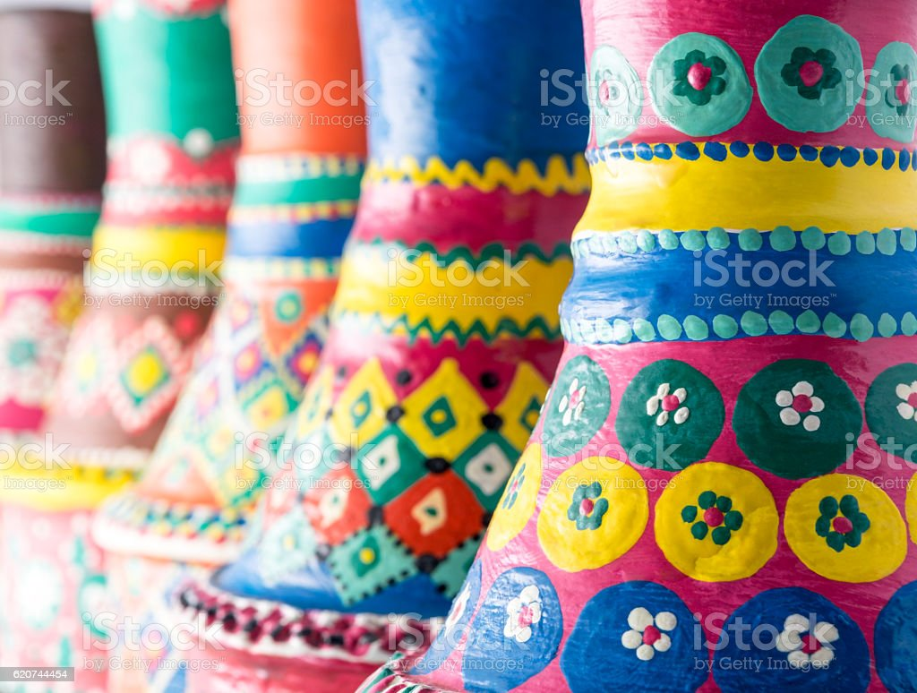 Composition of artistic painted clorful handcrafted pottery vases stock photo