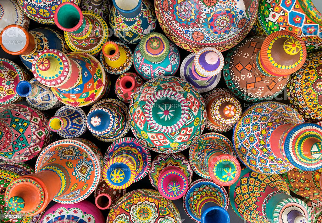 Composition of artistic painted handcrafted pottery jars stock photo