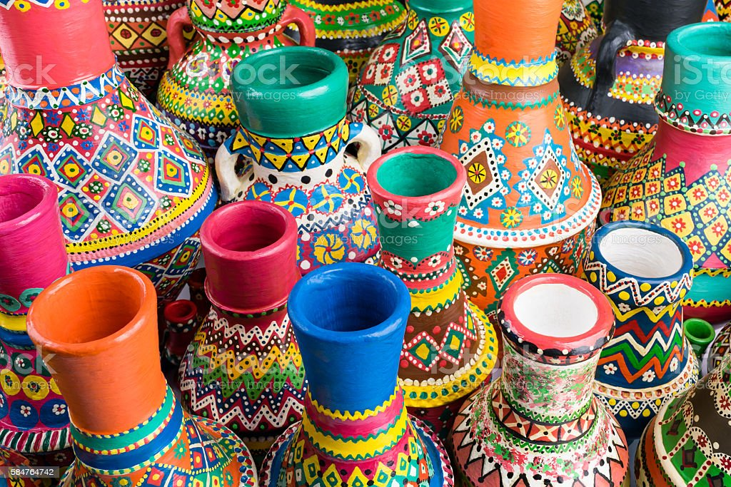 Composition of artistic painted handcrafted pottery vases stock photo