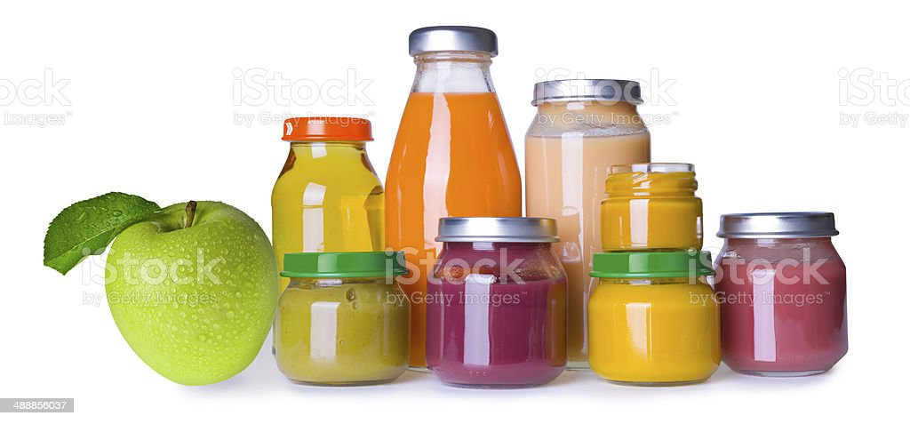 Composition of baby food jars and juice bottles on white stock photo