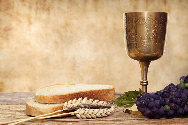 composition of communion chalice and bread - communion stock photos and pictures