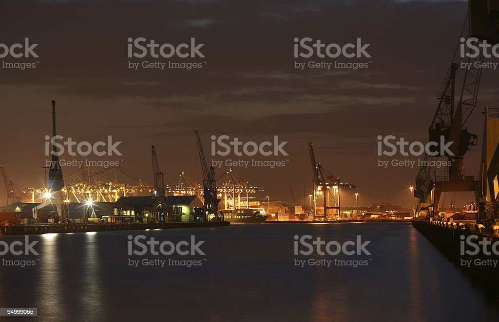 Composition of cranes in a harbor royalty-free stock photo