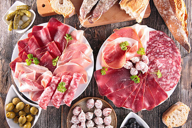 composition of delicatessen - delis stock photos and pictures