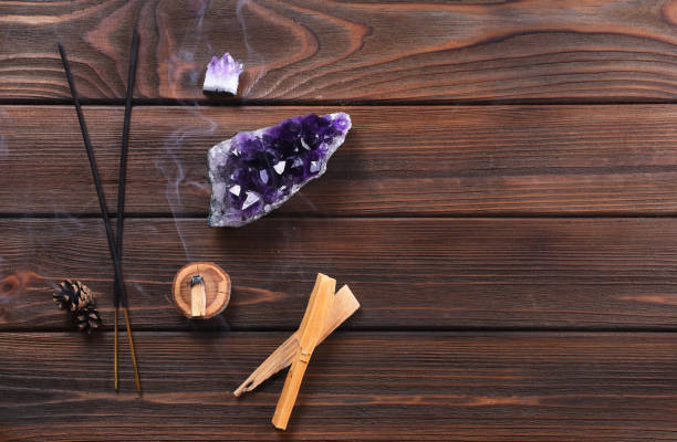 Composition of esoteric objects used for healing, meditation, relaxation and purifying. Amethyst stones, palo santo wood, Aromatic sticks on dark background. Composition of esoteric objects used for healing, meditation, relaxation and purifying. Amethyst stones, palo santo wood, Aromatic sticks on dark background. incense stock pictures, royalty-free photos & images