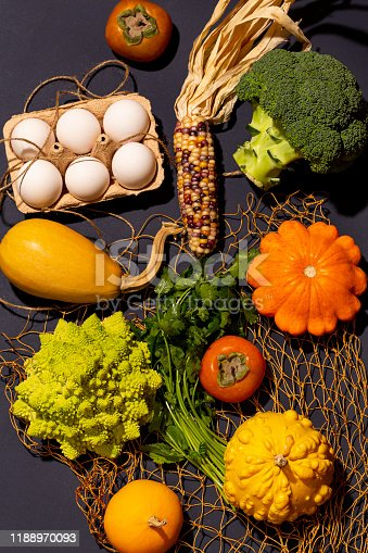 Vibrant ripe pumpkins, cauliflowers and other farmers' products flat lay.