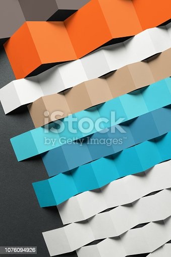 532107582istockphoto Composition of folded paper in geometric shapes, texture background 1076094926