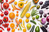 Iridescent food. Creative composition made of fruits and vegetables in rainbow colors on white background, flat lay