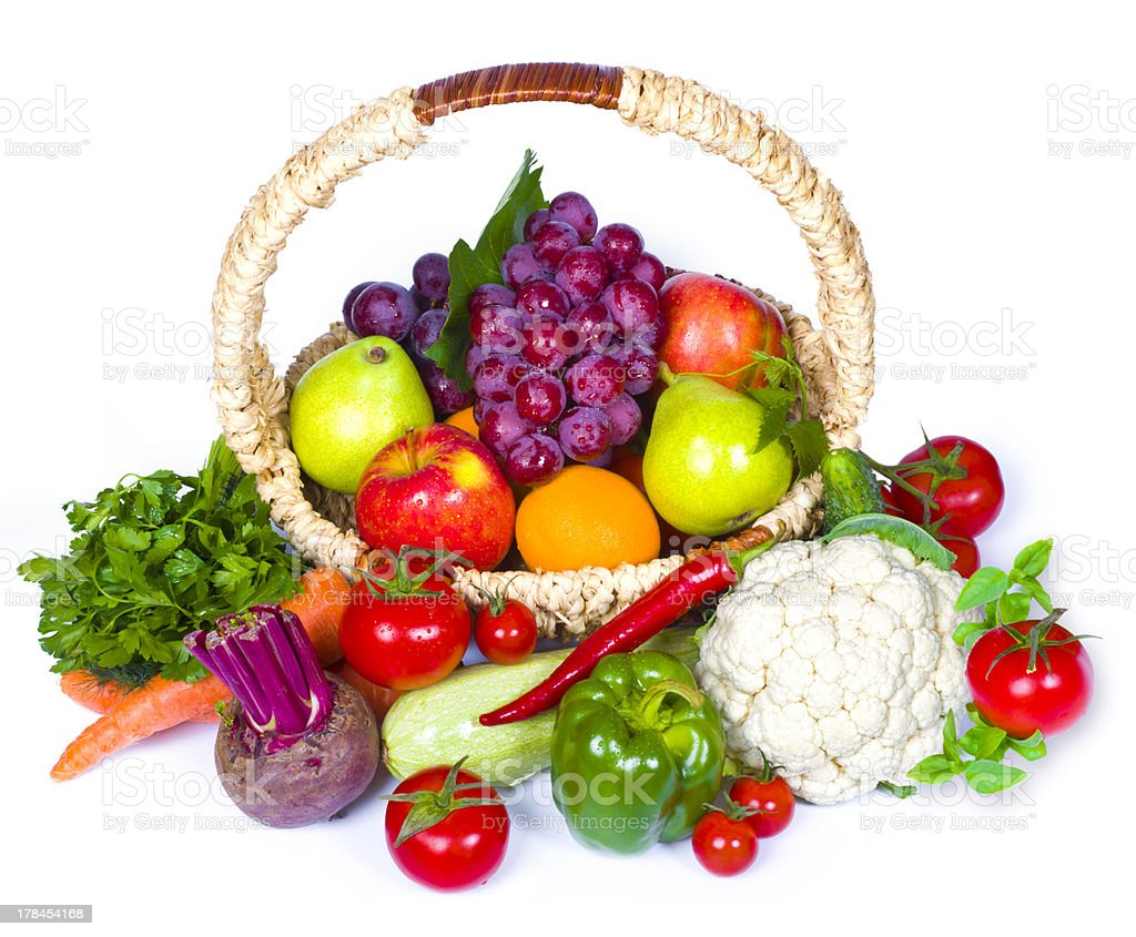 composition of fruits and vegetables in wicker basket stock photo