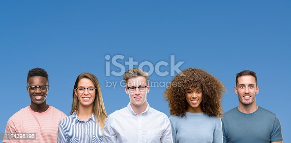 istock Composition of group of friends over blue blackground with a happy and cool smile on face. Lucky person. 1124398198