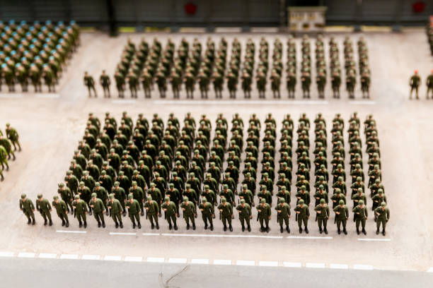 composition of many toy soldiers composition of many toy soldiers. construction of soldiers on the ground military parade stock pictures, royalty-free photos & images