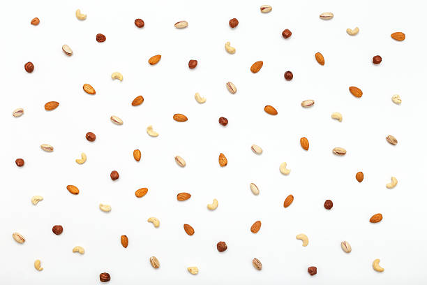 Composition of nuts pattern - mix hazelnuts, cashews, almonds, pistachios. stock photo