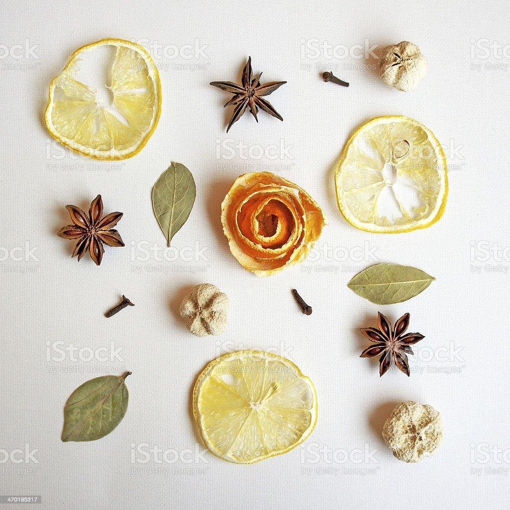 Composition of orange peel, star anise, bay leaves, lemon circles,...