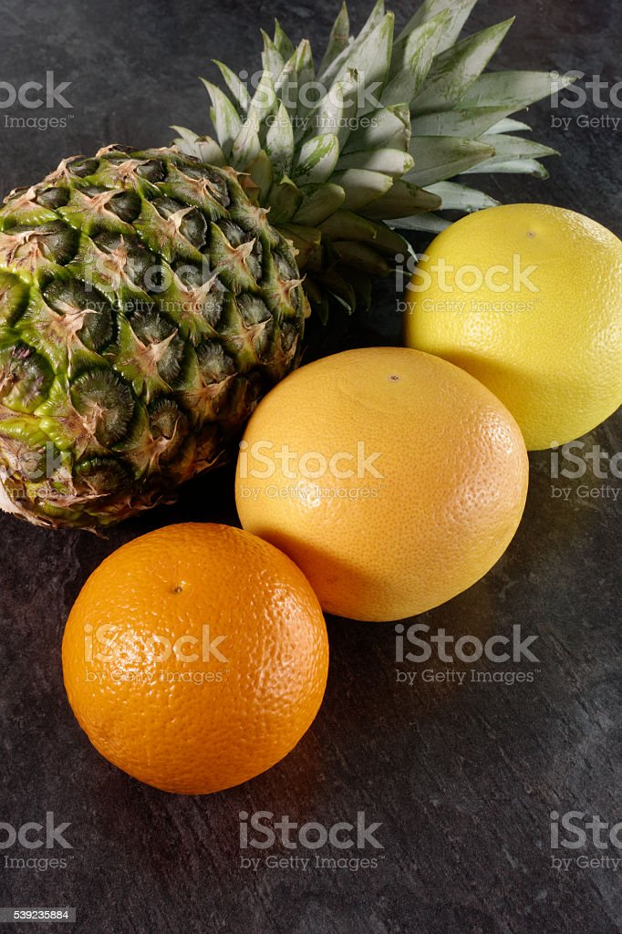 Composition of Pineapple, Orange and Grapefruits royalty-free stock photo
