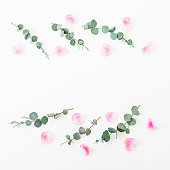 istock Composition of pink petals and eucalyptus on white background. Flat lay, top view. Valentine's background. 838402666