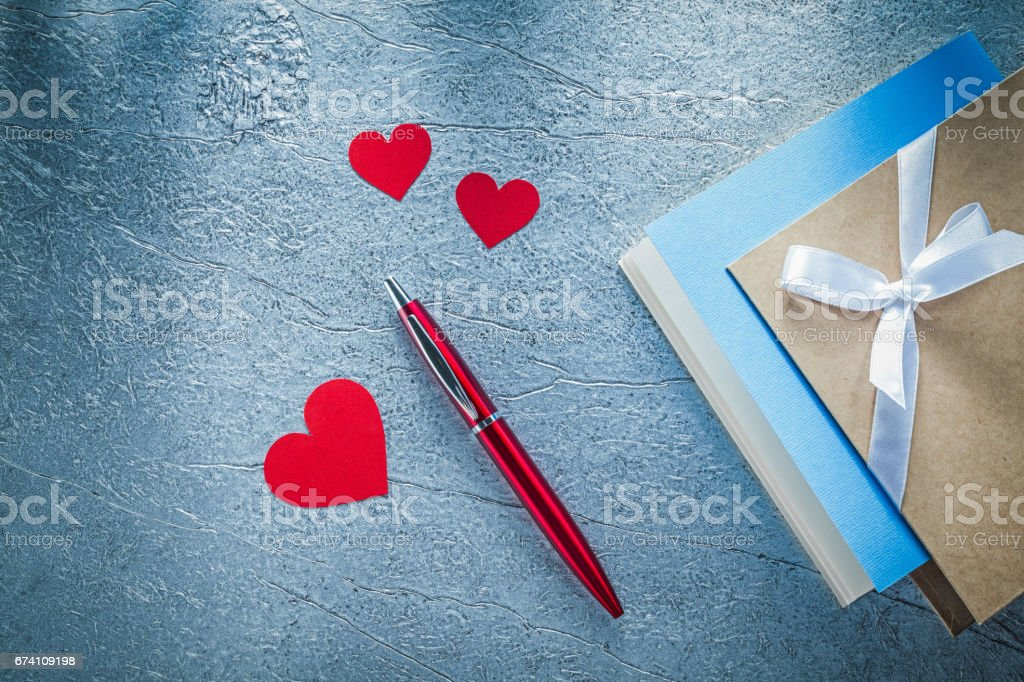 Composition of red hearts ballpoint pen vintage writing books on royalty-free stock photo