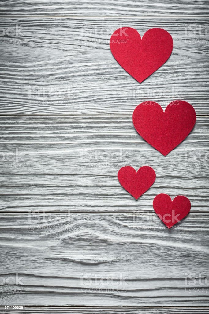 Composition of red hearts on wooden board Valentine cards royalty-free stock photo