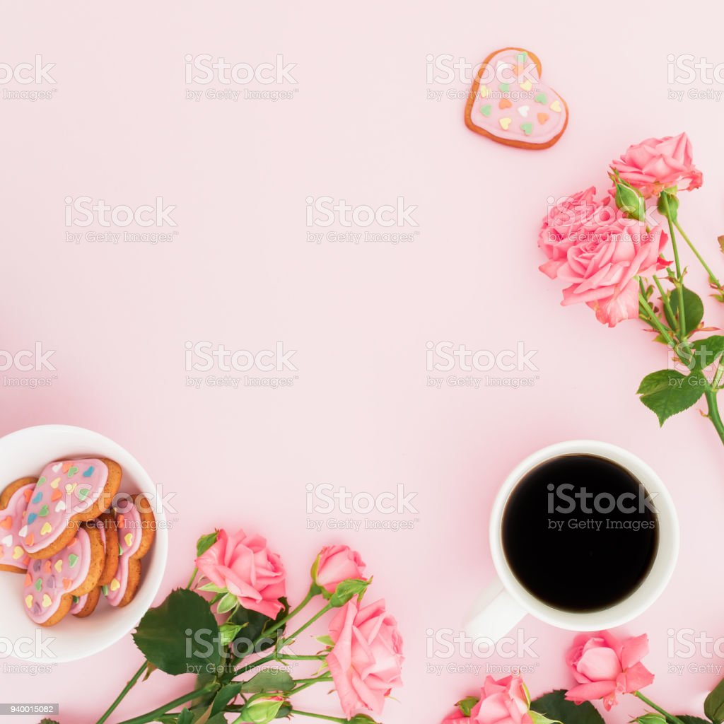 Composition Of Roses Flowers Cookies And Cup Of Coffee On Pink