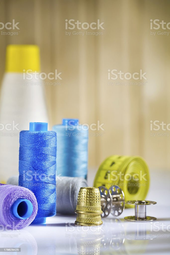 composition of sewing items on a white wooden table stock photo