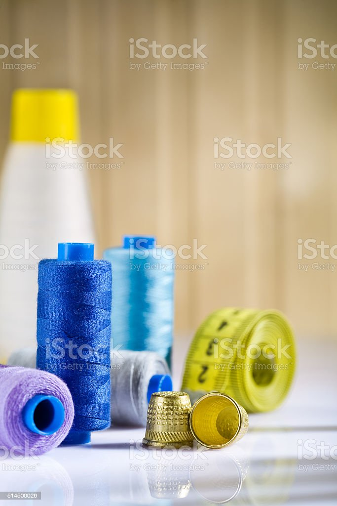composition of spools and thimbles with measure tape stock photo