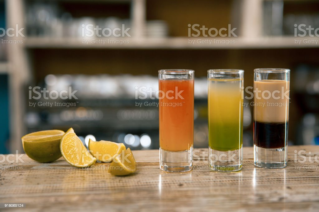 Christmas Drinks Alcohol.A Composition Of Three Colorful Shot Drinks Alcoholic