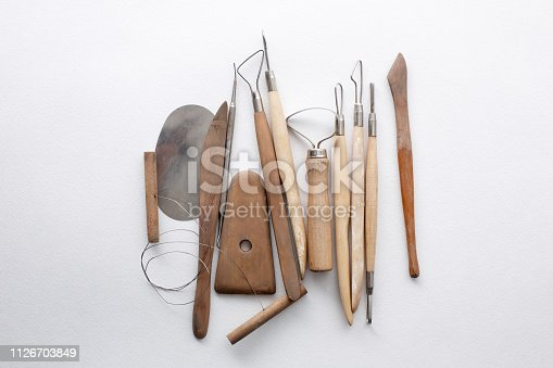 composition of tools for sculptors on white background