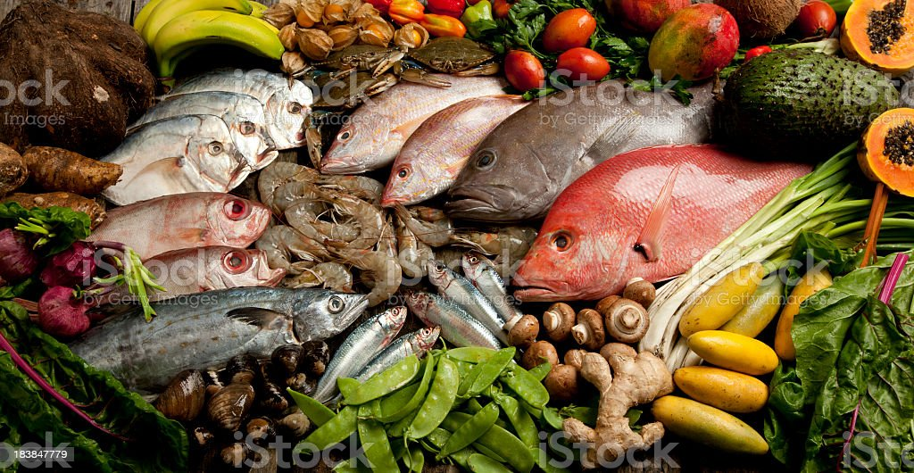 A composition of various seafood, vegetables, and fruits royalty-free stock photo
