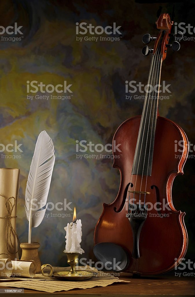 composition of violin and antique items stock photo