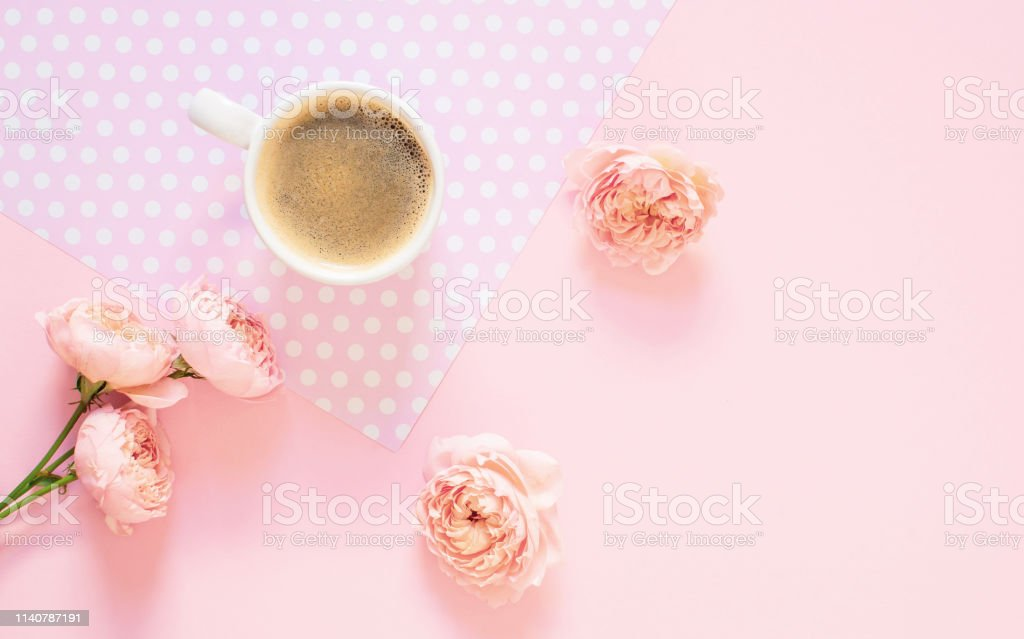 Composition of white cup with black coffee and flowers on a light...
