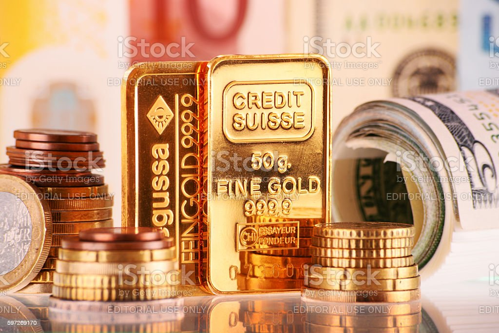 Composition with 50 gram gold bar, banknotes and coins royalty-free stock photo
