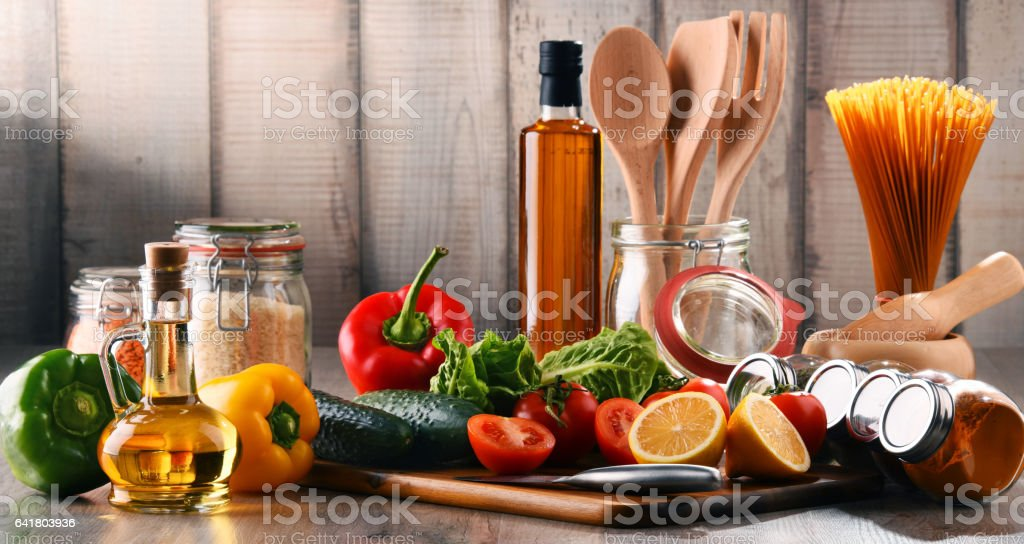 Composition with assorted food products and kitchen utensils stock photo