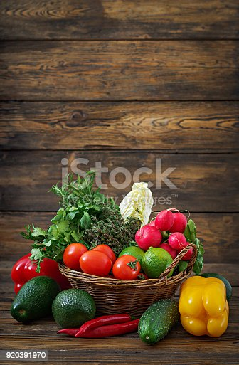 istock Composition with assorted raw organic vegetables and fruits. Detox diet 920391970