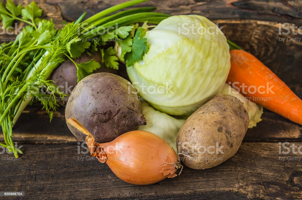 Composition with assorted raw vegetables on the wooden background stock photo