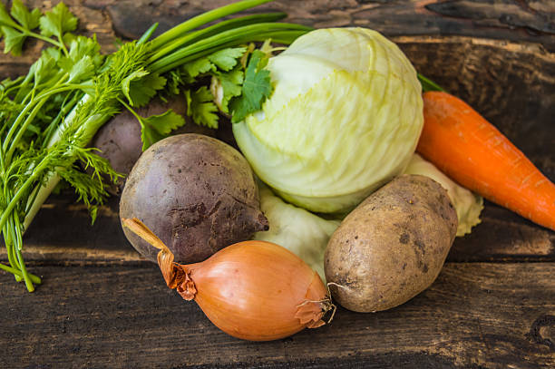 Composition with assorted raw vegetables on the wooden background - foto stock